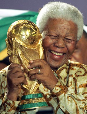 Former South African President Nelson Mandela holds the football World Cup Trophy in May 2004