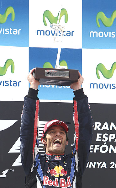 Mark Webber with his trophy after winning the Spanish GP