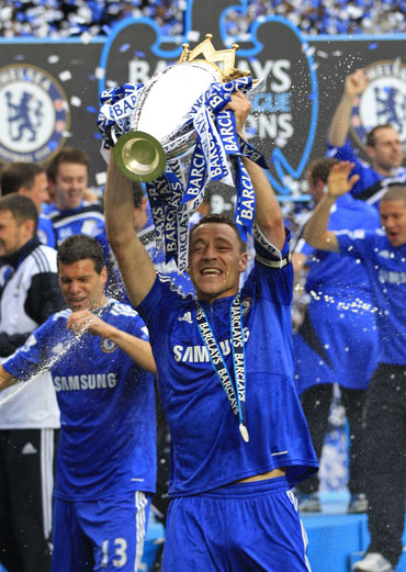 John Terry picks up the EPL trophy
