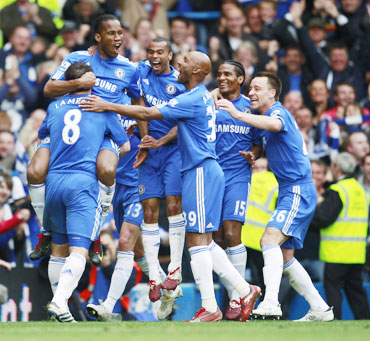 Chelsea players celebrate after winning