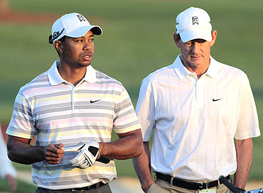 Tiger Woods (left) with former coach Hank Haney