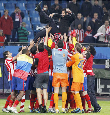 Atletico Madrid's players celebrate after their win over Fulham