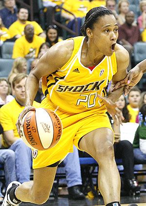 Tulsa Shock guard Marion Jones drives against the Minnesota Lynx