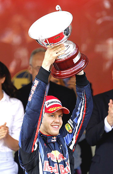 Red Bull's Sebastian Vettel with his trophy after finishing second
