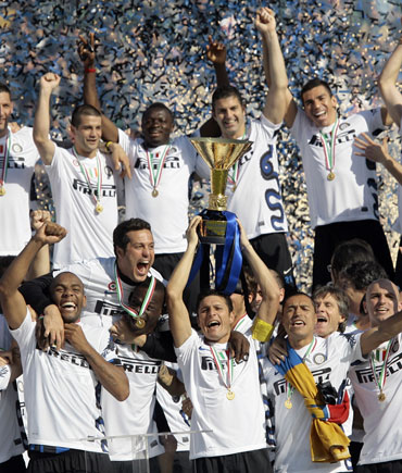 Javier Zanetti lifts the trophy after Inter won the Serie A title