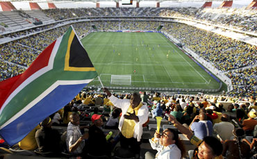 A fan waving South Africa's flag