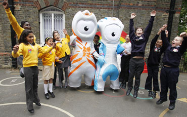 Mascots play with students from St. Paul's primary school