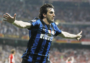 Diego Milito celebrates after scoring