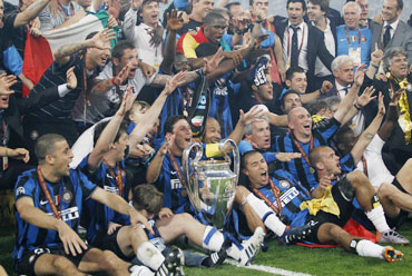 Inter Milan players celebrate after winning the trophy