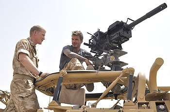 David Beckham (right) is shown a Grenade Machine Gun during a visit to Camp Bastion in Afghanistan