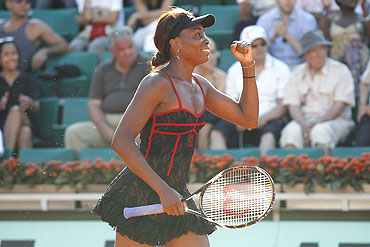 Venus Williams of the US celebrates winning her match against Patty Schnyder of Switzerland