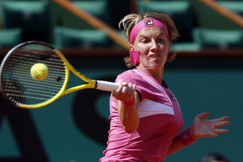 Svetlana Kuznetsova of Russia returns a shot to Sorana Cirstea of Romania