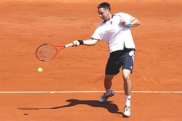 Robin Soderling of Sweden returns the against Laurent Recouderc of France