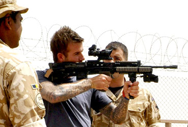 Beckham is shown some of the weapons used by front line troops