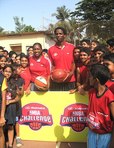 Former WNBA champion Teresa Edwards (left) and AC Green with participants at the Mahindra NBA challenge in Mumbai