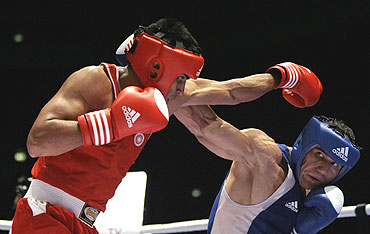 Vijender Singh (left) in action during a bout in Milan