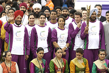 Chairman of the Selection Committee of the Athletics Federation of India, Gurbachan Singh Randhawa (right), is flanked by, (L-R) 1958 Commonwealth 400m gold medal winner Milka Singh, Indian national five times ladies squash champion Misha Soni, Olympic Gold medallist shooter Abhinav Bindra, hockey player Dilip Tirkey, British Olympian Kelly Holmes, English cricket player Monty Panesar and British Olympian Sebastian Coe during the CWG baton rally in London