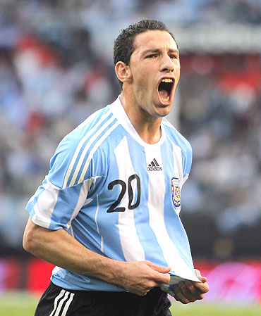 Argentina's Maxi Rodriguez celebrates after scoring against Canada