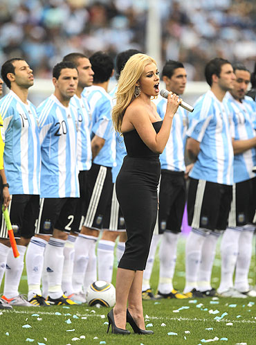 Welsh meezzo-soprano Katherine Jenkins sings the Canadian anthem before the friendly tie between Argentina and Canada