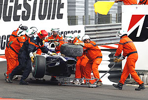 Track marshals remove the car of Williams Formula One driver Hulkenberg of Germany after he crashed out of the race during the Monaco F1 Grand Prix in Monte Carlo