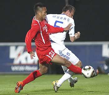 Greece's Evangelos Moras (right) challenges North Korea's Jong Tae-se during their international friendly soccer match in Altach