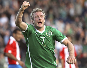 Ireland's Liam Lawrence celebrates after scoring against Paraguay