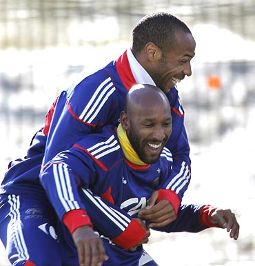 France strikers Thierry Henry left and Nicolas Anelka share a light moment during a training session in Tignes