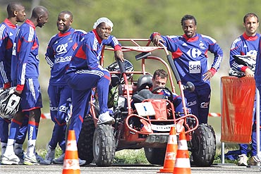 French players prepare to compete in a dune buggy race
