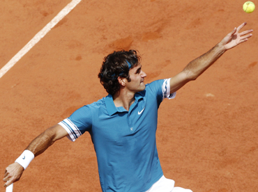 Roger Federer of Switzerland serves during his match against Alejandro Falla of Colombia