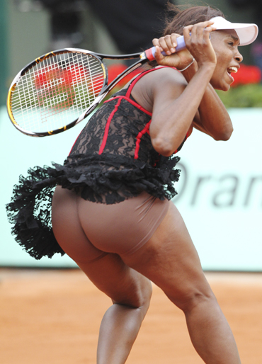 Venus Williams of the U.S. plays a shot during her match against Arantxa Parra Santonja of Spain