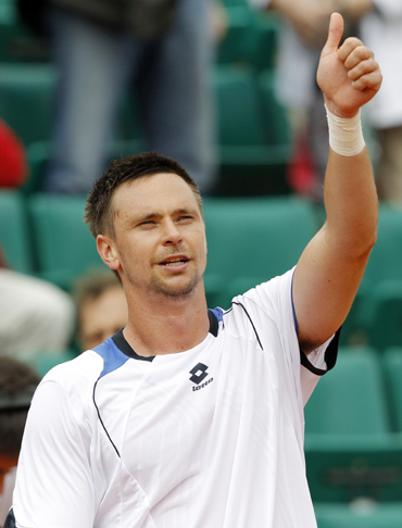 Soderling reacts after winning his match against Dent during the French Open