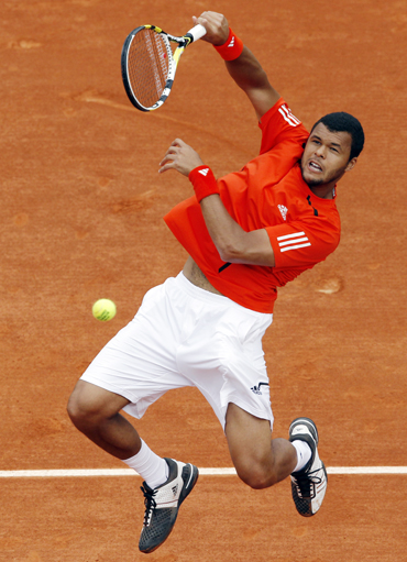 Tsonga of France returns the ball to his compatriot Ouanna