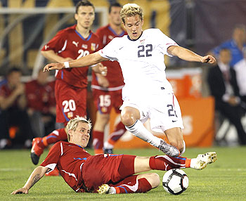 Czech Republic's Tomas Hubschman (bottom) tackles the Stuart Holden of the US during a football friendly on Tuesday