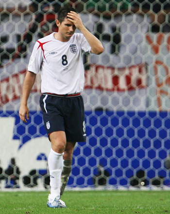 England's Frank Lampard reacts after missing penalty during penalty shootout in World Cup 2006 quarter-final soccer match