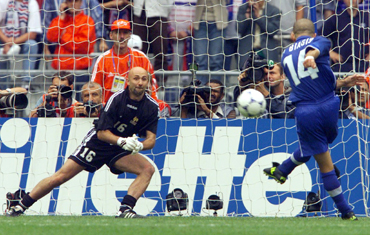Italy's Luigi Di Biagio shoots his crucial penalty shot which was saved by French goalkeeper Fabien Barthez