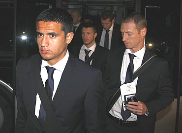 Tim Cahill (left) and his Australian team-mates arrive at Johannesburg airport