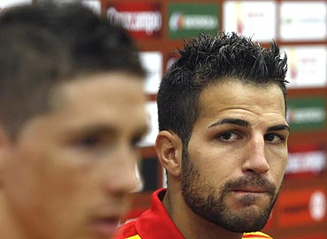 Spain's Cesc Fabregas (right) listens to team-mate Fernando Torres during a press conference