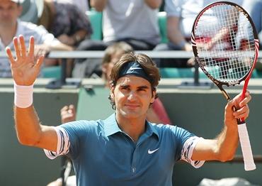 Federer celebrates after victory over German qualifier Julian Reister