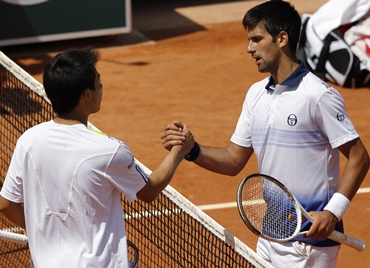 Djokovic of Serbia shakes hands with Nishikori after winning