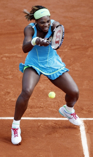 Serena Williams returns the ball to Goerges