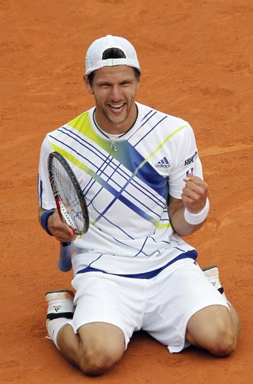 Jurgen Melzer celebrates after defeating David Ferrer
