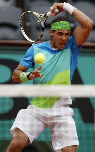 Rafa Nadal returns the ball to Lleyton Hewitt