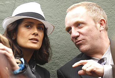 Actress Salma Hayek and husband Francois-Henri Pinault, watch the match between Federer and Wawrinka