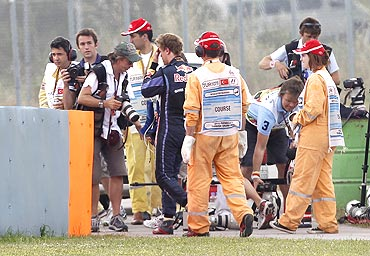 Red Bull's Sebastian Vettel (centre) walks after crashing out during the Turkish F1 Grand Prix