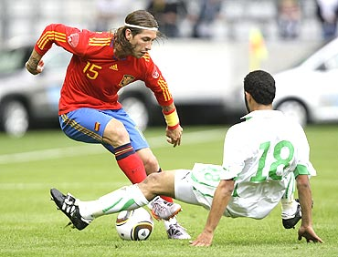Spain's Sergio Ramos (left) and Saudi Arabia's Yasser Al Qahtani fight for possession during an international friendly in Innsbruck