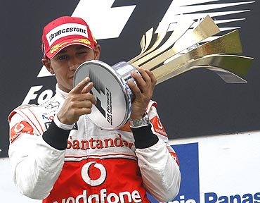 Lewis Hamilton with the trophy