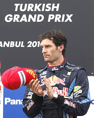 Red Bull's Mark Webber on the podium after finishing 3rd