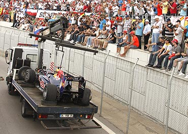 The car of Sebastian Vettel is transported out of the track in Istanbul