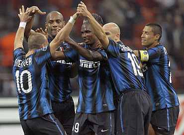 Inter Milan players celebrate after wining their match