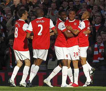 Arsenal players celebrate after scoring a goal